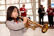 Mia Smith, 6, of Kettering tries out a trumpet during the 10th Anniversary Open House at the Schuster Center in downtown Dayton, Saturday, March 2, 2013.
