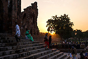 "5th February 2015, New Delhi, India. Worshippers ascend and descend steps in Feroz Shah Kotla in New Delhi, India on the 5th February 2015 <br /> <br /> PHOTOGRAPH BY AND COPYRIGHT OF SIMON DE TREY-WHITE a photographer in delhi. + 91 98103 99809. Email:simon@simondetreywhite.com<br /> <br /> People have been coming to Firoz Shah Kotla to leave written notes and offerings for Djinns in the hopes of getting wishes granted since the late 1970's. Jinn, jann or djinn are supernatural creatures in Islamic mythology as well as pre-Islamic Arabian mythology. They are mentioned frequently in the Quran  and other Islamic texts and inhabit an unseen world called Djinnestan. In Islamic theology jinn are said to be creatures with free will, made from smokeless fire by Allah as humans were made of clay, among other things. According to the Quran, jinn have free will, and Iblīs abused this freedom in front of Allah by refusing to bow to Adam when Allah ordered angels and jinn to do so. For disobeying Allah, Iblīs was expelled from Paradise and called ""Shayṭān"" (Satan).They are usually invisible to humans, but humans do appear clearly to jinn, as they can possess them. Like humans, jinn will also be judged on the Day of Judgment and will be sent to Paradise or Hell according to their deeds. Feroz Shah Tughlaq (r. 1351–88), the Sultan of Delhi, established the fortified city of Ferozabad in 1354, as the new capital of the Delhi Sultanate, and included in it the site of the present Feroz Shah Kotla. Kotla literally means fortress or citadel."