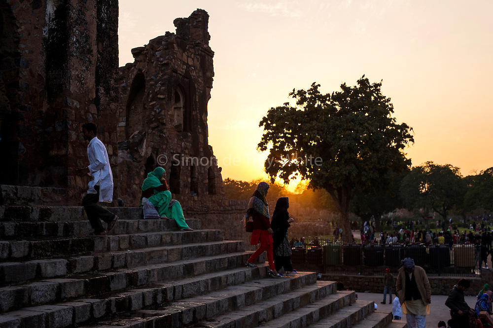 5th February 2015, New Delhi, India. Worshippers ascend and descend steps in Feroz Shah Kotla in New Delhi, India on the 5th February 2015 <br /> <br /> PHOTOGRAPH BY AND COPYRIGHT OF SIMON DE TREY-WHITE a photographer in delhi. + 91 98103 99809. Email:simon@simondetreywhite.com<br /> <br /> People have been coming to Firoz Shah Kotla to leave written notes and offerings for Djinns in the hopes of getting wishes granted since the late 1970's. Jinn, jann or djinn are supernatural creatures in Islamic mythology as well as pre-Islamic Arabian mythology. They are mentioned frequently in the Quran  and other Islamic texts and inhabit an unseen world called Djinnestan. In Islamic theology jinn are said to be creatures with free will, made from smokeless fire by Allah as humans were made of clay, among other things. According to the Quran, jinn have free will, and Iblīs abused this freedom in front of Allah by refusing to bow to Adam when Allah ordered angels and jinn to do so. For disobeying Allah, Iblīs was expelled from Paradise and called &quot;Shayṭān&quot; (Satan).They are usually invisible to humans, but humans do appear clearly to jinn, as they can possess them. Like humans, jinn will also be judged on the Day of Judgment and will be sent to Paradise or Hell according to their deeds. Feroz Shah Tughlaq (r. 1351&ndash;88), the Sultan of Delhi, established the fortified city of Ferozabad in 1354, as the new capital of the Delhi Sultanate, and included in it the site of the present Feroz Shah Kotla. Kotla literally means fortress or citadel.