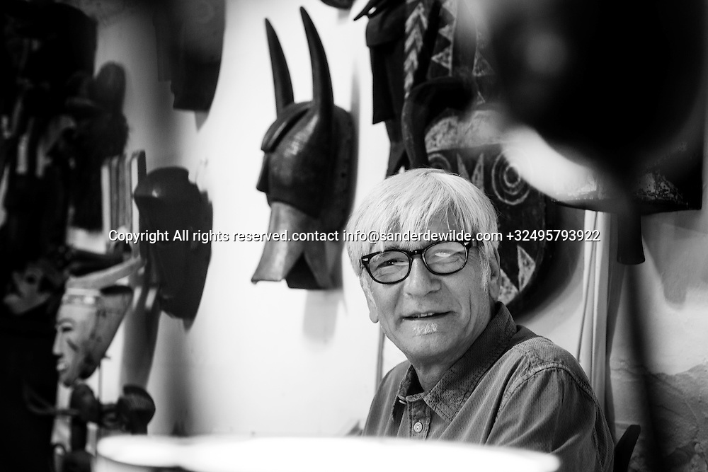 Brussels, Belgium 29 August 2014. Johan De Moor, famous Belgian cartoonist and son of Bob De Moor, right hand of Tintin's Hergé in his studio with african masks. © Sander de Wilde pour M le magazine du Monde