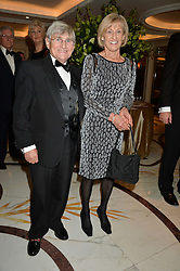 WILLIE CARSON and his wife ELAINE at the 24th Cartier Racing Awards held at The Dorchester, Park Lane, London on 11th November 2014.