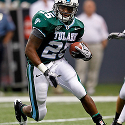 Sep 11, 2010; New Orleans, LA, USA; Tulane Green Wave running back Albert Williams (25) runs against the Mississippi Rebels during the second half at the Louisiana Superdome. The Mississippi Rebels defeated the Tulane Green Wave 27-13.  Mandatory Credit: Derick E. Hingle