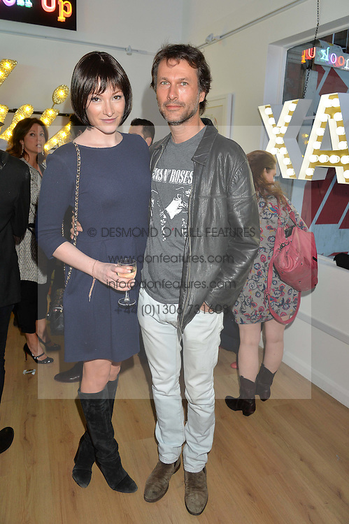 JAMES DEWAR and SARAH BURKEMAN at a private view of an exhibition entitled 'All Shook Up' - by Natasha Archdale: A Retrospective held at 90 Piccadilly, London on 23rd April 2015.