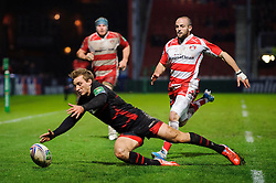 Edinburgh Winger (#11) Tom Brown beats Gloucester replacement (#23) Charlie Sharples back to the ball during the second half of the match - Photo mandatory by-line: Rogan Thomson/JMP - Tel: 07966 386802 - 15/12/2013 - SPORT - RUGBY UNION - Kingsholm Stadium, Gloucester - Gloucester Rugby v Edinburgh Rugby - Heineken Cup Round 4.
