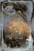 extreme deteriorated image of a soldier studio portrait France 1900s