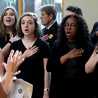 Members of the Tupelo High School Vocal Jazz Ensemble perform the NAtional Anthem to start off the Northeast Mississippi Fallen Officers Memorial Service Thursday night at the Elvis Presley Birthplace in Tupelo.