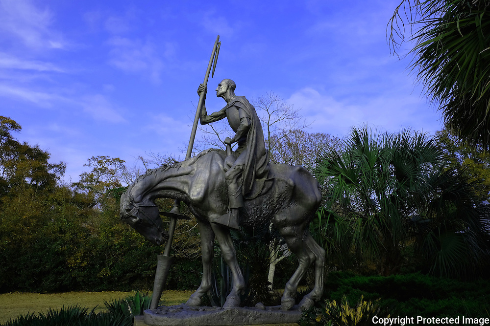 Brookgreen Gardens, in Murrells Inlet, South Carolina, is a sculpture garden and wildlife preserve which includes several themed gardens with American figurative sculptures and trails of nature reserves on the 9,100 acre property.  It was founded by Archer Milton Huntington and his wife Anna Hyatt Huntington to feature sculptures by Anna and her sister Harriet Hyatt along with other American Sculptors.   I was built on a former rice plantation - Brookgreen Plantation.  During the Christmas season many of the sculptures and live oak trees are dressed in brilliant lights.  It is one of the most popular attractions in South Carolina.  This is a sculpture of Don Quixote, the Man of La Mancha.