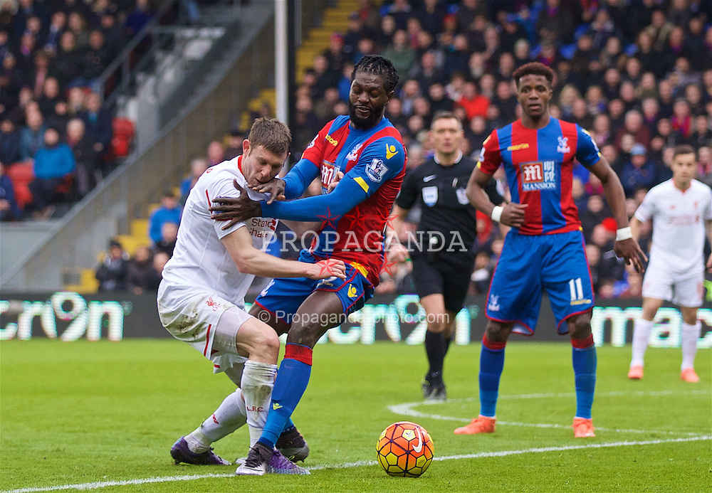 LONDON, ENGLAND - Sunday, March 6, 2016: Liverpool's James Milner is blocked by Crystal Palace's Emmanuel Adebayor during the Premier League match at Selhurst Park. (Pic by David Rawcliffe/Propaganda)