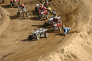 The fourth picture of the sequence of a crash at the ATVA MX National Feb 4-5, 2006 at Glen Helen. The fourth picture displays Jerimiah Jones (#2)rolling in front of Joe Byrd (#7) as his bike takes a turn into on coming traffic. Doug Gust (#55) makes a move to the inside to avoid Byrd and right in front of the group that is already stacking up behind Farr.