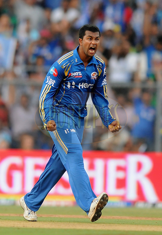 Pragyan Ojha of Mumbai Indians celebrate the wicket of Nitin Saini of Kings XI Punjab during match 28 of the Indian Premier League ( IPL) 2012  between The Mumbai Indians and the Kings X1 Punjab held at the Wankhede Stadium in Mumbai on the 22nd April 2012..Photo by Pal Pillai/IPL/SPORTZPICS.