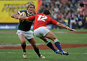 Wynand Olivier of the Springboks slips a tackle of Riki Flutey of the Lions.<br /> Rugby - 090704 - Springboks vs British&Irish Lions - Coca-Cola Park - Johannesburg - South Africa. The Lions won 28-9 but lost the series 2-1 to the Springboks.<br /> Photographer : Anton de Villiers / SASPA