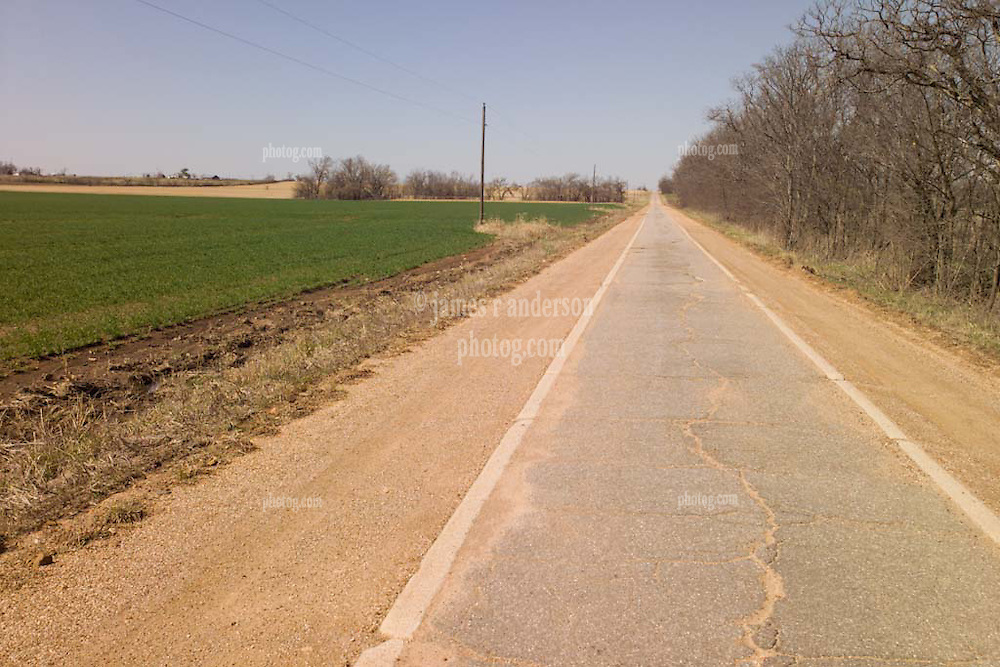 "Old US Route 66 south of Miami Oklahoma. Original alignment consisting of Portland Cement just 15 feet wide here, sometimes refered to as ""Sidewalk Highway"""