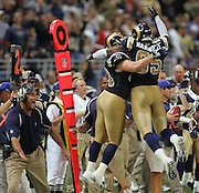 ST. LOUIS - SEPTEMBER 23:  Defensive end Anthony Hargrove #95 and defensive end Brandon Green #93 of the St. Louis Rams celebrate after a fumble recovery by teammate Adam Archuleta late in the game against the New Orleans Saints at the Edward Jones Dome on September 23, 2005 in St. Louis, Missouri. The Rams defeated the Saints 28-17. ©Paul Anthony Spinelli *** Local Caption *** Anthony Hargrove;Brandon Green