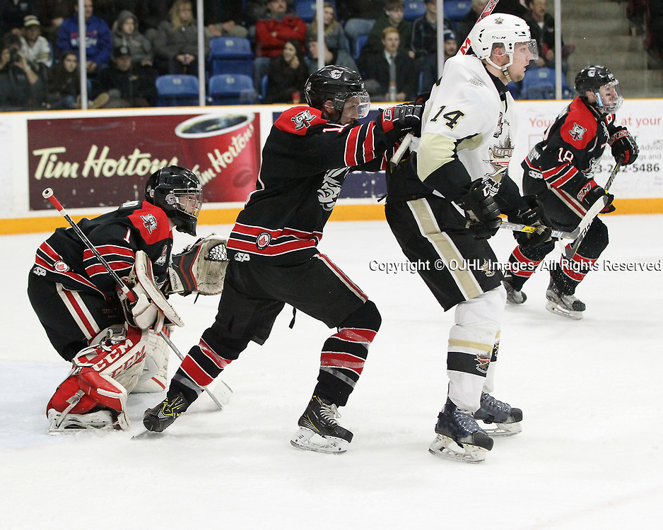 TRENTON, ON  - APR 15,  2017: Ontario Junior Hockey League, Championship Series. Georgetown Raiders vs the Trenton Golden Hawks in Game 2 of the Buckland Cup Final. Keegan Blasby #11 of the Georgetown Raiders protects the crease from Rex Moe #14 of the Trenton Golden Hawks during the second period.<br /> (Photo by Tim Bates / OJHL Images)