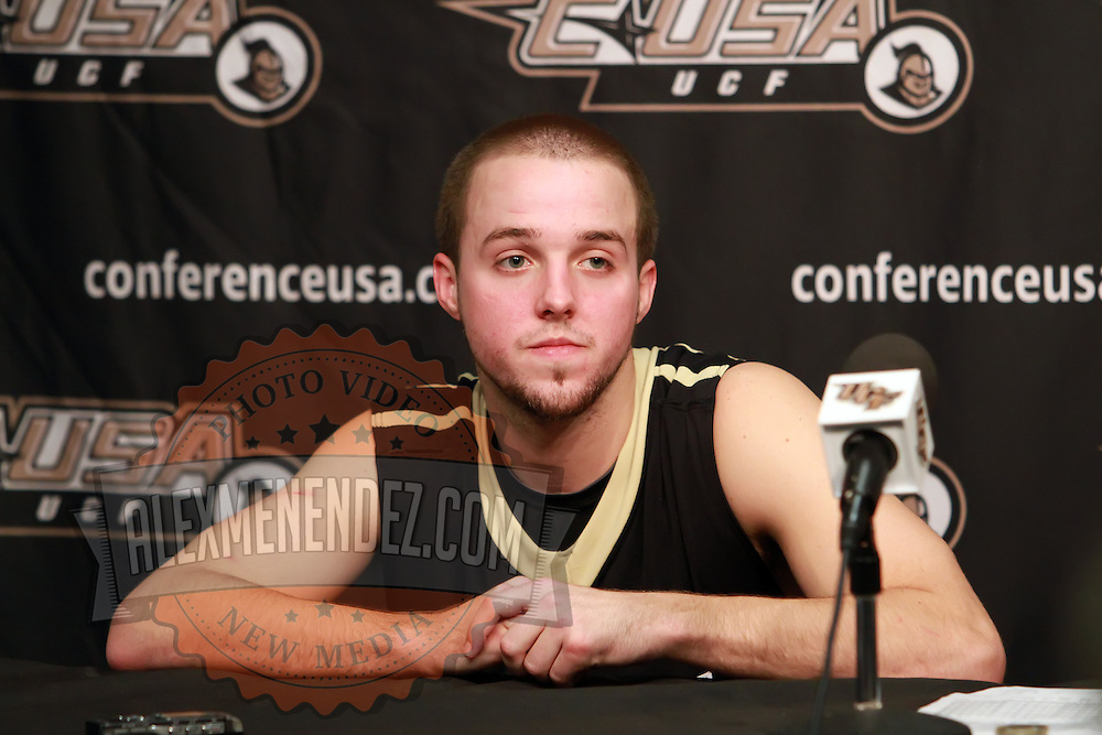 Central Florida guard A.J. Rompza (3) speaks to the media after the NCAA basketball game against the USF Bulls at the UCF Arena on November 18, 2010 in Orlando, Florida. UCF won the game 65-59. (AP Photo/Alex Menendez)