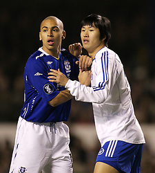Liverpool, England - Wednesday, December 5, 2007: Everton's james Vaughan and Zenit St. Petersburg's Lee Ho during the UEFA Cup Group A match at Goodison Park. (Photo by David Rawcliffe/Propaganda)