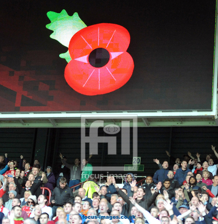 Fans after observing a min silence in rememberance during the Sky Bet Championship match at the John Smiths Stadium, Huddersfield<br /> Picture by Graham Crowther/Focus Images Ltd +44 7763 140036<br /> 01/11/2014