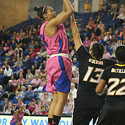 Delaware Center Kelsey Buchanan (13) shots a jump shot as Towson Tigers Forward Camille Alberson (13) defends in the first half of a NCAA regular season Colonial Athletic Association conference game between Delaware and The Towson Tigers Sunday, Feb 16, 2014 at The Bob Carpenter Sports Convocation Center in Newark Delaware.