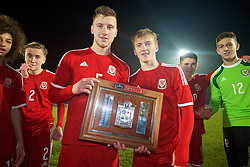 BALLYMENA, NORTHERN IRELAND - Thursday, November 20, 2014: Wales' Daniel Jefferies and Matty Smith with the trophy after the 2-0 victory over Northern Ireland during the Under-16's Victory Shield International match at the Ballymena Showgrounds. (Pic by David Rawcliffe/Propaganda)