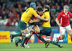 © SPORTZPICS/ Seconds Left Images 2011 - Wales' Mike Phillips tries to beat Australia's Ben McCalman (R) & Australia's James Horwill (captain) (L) Wales v Australia - Rugby World Cup 2011 - Bronze Final - Eden Park - Auckland - New Zealand - 21/10/2011 -  All rights reserved..
