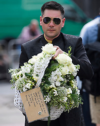 © Licensed to London News Pictures. 03/06/2018. London, UK. Flowers left by Borough Market ahead of a minutes silence for the victims of the 2017 London Bridge Terror attack, held on London Bridge. Eight people were killed and 48 were injured when a van was deliberately driven into pedestrians on London Bridge. Three occupants then ran to the nearby Borough Market area carrying knives and fake explosives. Photo credit: Ben Cawthra/LNP