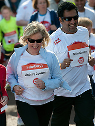 Eastenders actors Lindsey Coulson and Nitin Ganatra taking part in a one mile run for Sport Relief charity in London, 25th March 2012.  Photo by: i-Images