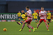 Doncaster Rovers Jordan Houghton(16) does a crunching tackle on  Oxford United Wes Thomas (9) during the EFL Sky Bet League 1 match between Oxford United and Doncaster Rovers at the Kassam Stadium, Oxford, England on 9 December 2017. Photo by Gary Learmonth.
