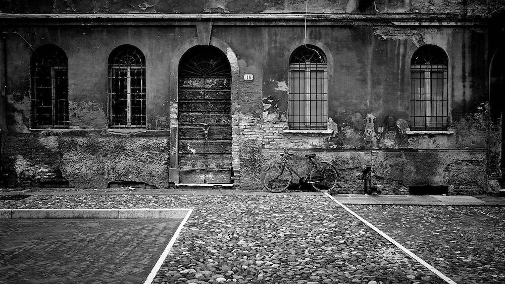Courtyard, Mantua, Italy. A series of captures from a personal trip to the cities of Milan and Mantua, featuring explorations of Renaissance architecture and the vibrant life of Italian streets.