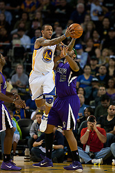 April 10, 2011; Oakland, CA, USA;  Golden State Warriors shooting guard Monta Ellis (8) is defended by Sacramento Kings power forward DeMarcus Cousins (15) during the first quarter at Oracle Arena.