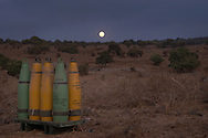IDF artillery ammunition out in the Golan Heights fields at night. 2nd Lebanon War. Israel, August 2006.