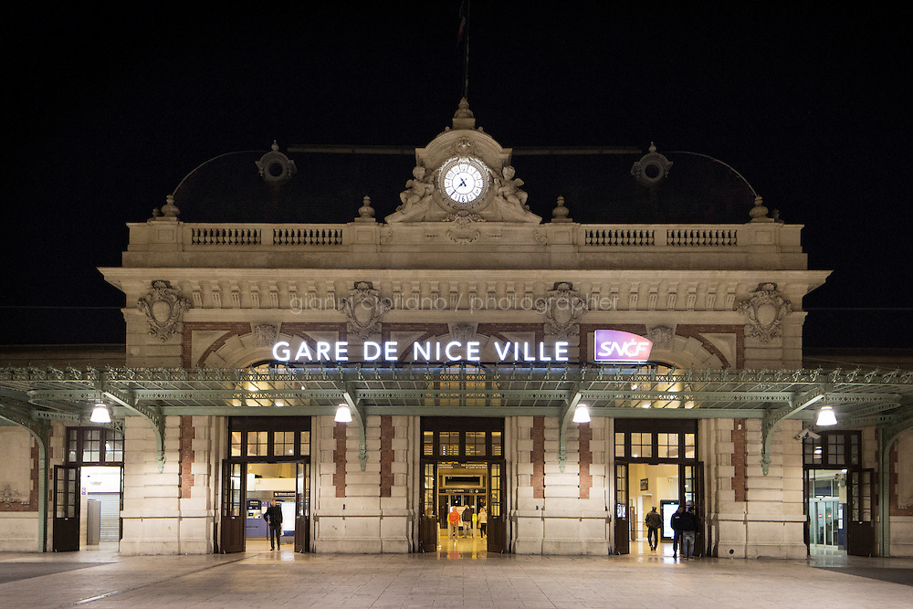 NICE, FRANCE - 17 NOVEMBER 2014: A train station ofNice, France,  where migrants stop before pursuing their journey to Paris, on November 17th 2014. Migrants stay around the waiting hall of the Nice train station for hours, sometime days, before taking the train to Paris. Some stop in Paris, but the majority continues the journey to Calais (before arriving in London), while others go to countries such Germany, the Netherlands, and Sweden.