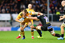 Tom Willis of Wasps is tackled by Dave Ewers of Exeter Chiefs - Mandatory by-line: Dougie Allward/JMP - 30/11/2019 - RUGBY - Sandy Park - Exeter, England - Exeter Chiefs v Wasps - Gallagher Premiership Rugby