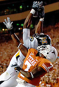 Missouri's Missouri wide receiver Danario Alexander, left, catches a pass from Chase Daniel in the endzone over Texas CB Deon Beasley that was later ruled incomplete during the second quarter.