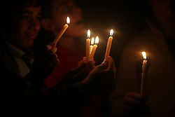 April 14, 2017 - Gaza, Gaza strip, Palestine - Palestinian boys hold candles during a protest against the blockade on Gaza, in Gaza City April 14, 2017. (Credit Image: © Majdi Fathi/NurPhoto via ZUMA Press)