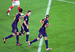 Lionel Messi is congratulated by Sergio Busquets and Cristian Tello after he makes the score 2-2  during the Group G UEFA Champions League match between FC Barcelona and Spartak Moscow at the Nou Camp, Barcelona, Spain 19th September 2012. Credit - Eoin Mundow/Cleva Media.