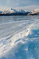 Sunrise over the wind blasted surface of Abraham Lake, Alberta Canada