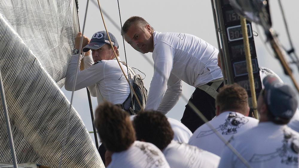 Bowman Alan Smith pulls the jib down at the Louis Vuitton Trophy Dubai. Dubai, United Arab Emirates, 23 November 2010. Photo: Subzero Images/Mascalzone Latino
