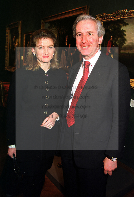 MR & MRS HUGO VICKERS he is the royal biographer, at an exhibition in London on 17th January 2000.OAC 22