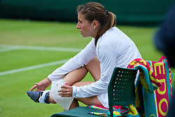 LONDON, ENGLAND - Wednesday, June 29, 2016: Annika Beck (GER) with an injury to her right heel during the Ladies' Singles 1st Round match on day three of the Wimbledon Lawn Tennis Championships at the All England Lawn Tennis and Croquet Club. (Pic by Kirsten Holst/Propaganda)