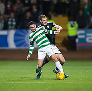 20th September 2017, Dens Park, Dundee, Scotland; Scottish League Cup Quarter-final, Dundee v Celtic; Dundee's Kevin Holt battles for the ball with Celtic's Patrick Roberts