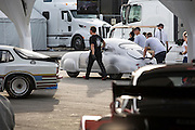 Image of the silver 1951 Porsche Gmund 356 SL 063 coupe which won its class at the 1951 Le Mans in France, being unveiled at Rennsport Reunion V, Laguna Seca, Monterey, Calfornia, America west coast. The Gmund was restored to its original look as it had finished Le Mans by Rod Emory and his team at Emory Motorsports in North Hollywood, California.