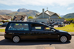 © Licensed to London News Pictures. 12/06/2015. Fort William, UK. Hearse carries ex-Liberal Democrat leader Charles Kennedy's coffin after the funeral at St John's Church in Caol, near his Fort William home in Scotland on Friday, June 12, 2015. Mr Kennedy died suddenly on June 1, 2015 at the age of 55 after suffering a major haemorrhage as a result of a long battle with alcoholism. Photo credit: Tolga Akmen/LNP