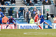 Coventry forward Adam Armstrong curls a shots wide of the far post under pressure from man of the match Gillingham defender Adam El-Abd, late in the game during the Sky Bet League 1 match between Gillingham and Coventry City at the MEMS Priestfield Stadium, Gillingham, England on 2 April 2016. Photo by David Charbit.