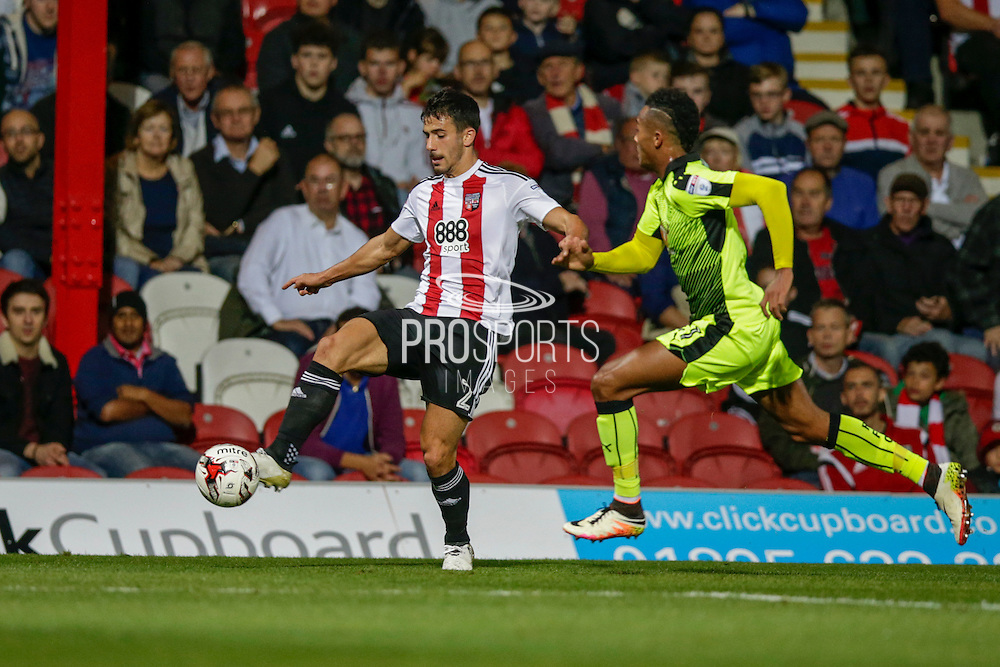 Maxine Colin receives from mid field with Jordan Obita close behind during the EFL Sky Bet Championship match between Brentford and Reading at Griffin Park, London, England on 27 September 2016. Photo by Jarrod Moore.