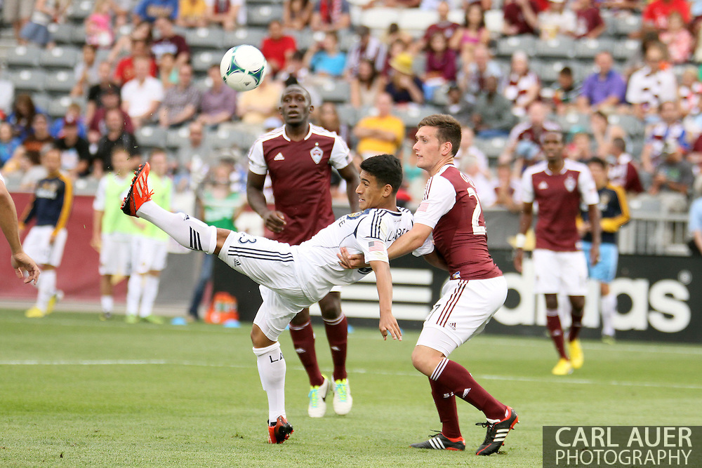 July 27th, 2013 - LA Galaxy forward Jose Villarreal (33) is unable to pull a bicycle kick and sends the ball over Colorado Rapids midfielder Shane O'Neill (27) and the goal in the second half of action in the Major League Soccer match between the LA Galaxy and the Colorado Rapids at Dick's Sporting Goods Park in Commerce City, CO