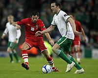 Football - Carling Nations Cup - Republic of Ireland vs. Wales<br /> Joe Ledley of Wales and John O'Shea during the  Republic of Ireland vs. Wales Carling Nations Cup at The Aviva Stadium