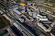 Nederland, Flevoland, Lelystad, 08-09-2009. Stadshart, centrum van de stad met onder in beeld het station, rechts het stadhuis, linksboven het oranje Agora theater en congrescentrum (architect Ben van Berkel UN-Studio). Er wordt gewerkt aan de revitalisering van het stadscentrum, projectontwikkeling, uitbreiding en nieuwbouw van winkels en woningen. .Center of the city, below the railway station, city hall (m), top left the orange Agora Theater and Convention Center (architect Ben van Berkel, UN Studio)..Revitalizing of the  downtown area, project development, expansion and new construction of homes and shops. .toeslag); aerial photo (additional fee required); .foto Siebe Swart / photo Siebe Swart