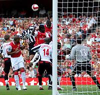 Photo: Ed Godden.<br />Arsenal v Sheffield United. The Barclays Premiership. 23/09/2006. Arsenal players Emmanuel Adebayor and  Johan Djourou (R) jump high for the ball.