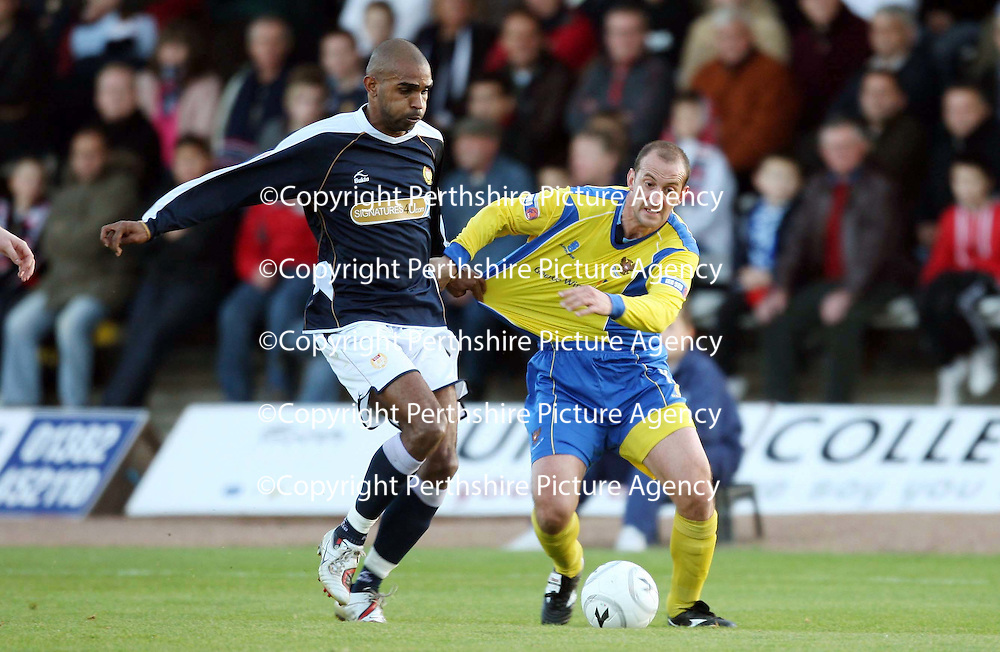 Dundee v St Johnstone....03.11.07<br /> Freddie Daquin grabs a hold of Paul Sheerin<br /> Picture by Graeme Hart.<br /> Copyright Perthshire Picture Agency<br /> Tel: 01738 623350  Mobile: 07990 594431