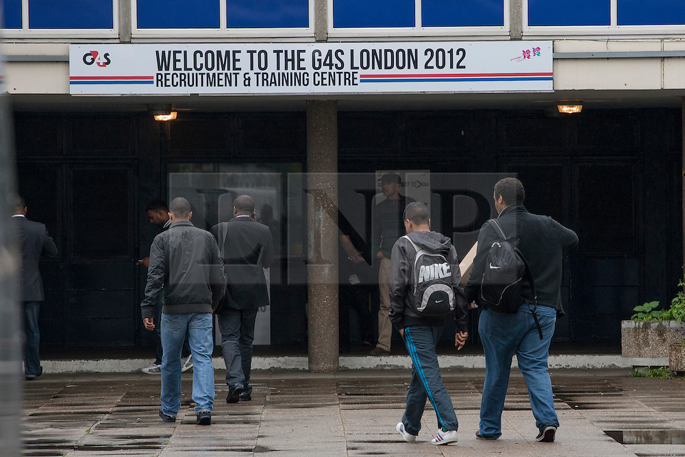 © licensed to London News Pictures. London, UK 14/07/2012. G4S's new recruitments walking to the company's Recruitment & Training Centre in Stratford this morning. Photo credit: Tolga Akmen/LNP